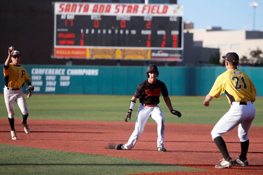 Artesia's Braxton McDonald gets picked off near first base against St. Pius during Saturday's 4A state baseball championship game at Santa Ana Star Field in Albuquerque.