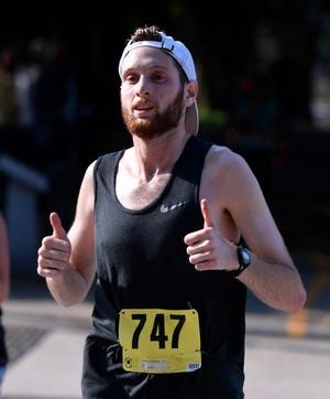Jonathan Schloth, 22 of Lynbrook NY, heads to the finish line of the annual York Marathon in record time, Sunday, May 19, 2019. John A. Pavoncello photo