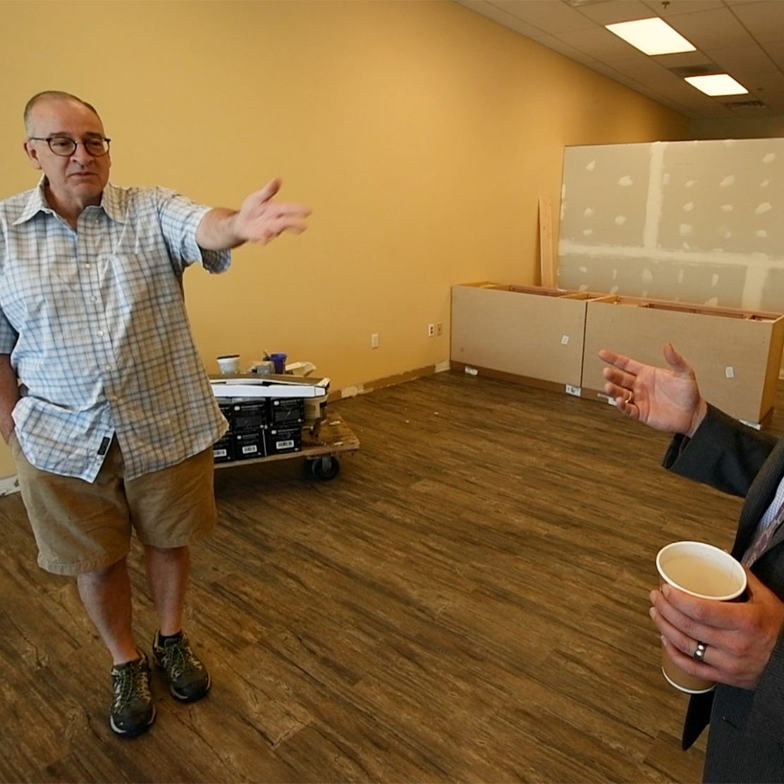 "District Judge Ronald Haskell Jr., left, talks with criminal defense attorney Jay Whittle who are partnering on opening a CBD American Shaman franchise store on East Market Street in Springettsbury Township. ""We want to educate people,"" said Whittle, who added that he wants people to stop buying CBD oil from gas stations. "" I'd rather educate someone than sell them something."""