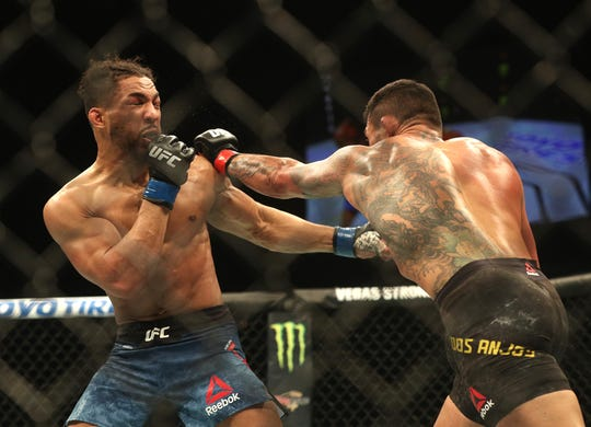 Rafael Dos Anjos lands a left against Kevin Lee.  Dos Anjos won by submission.