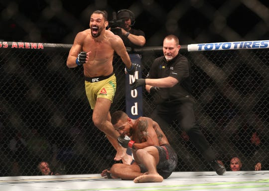 An excited Michel Pereira celebrates after beating Danny Roberts during the UFC Fight Night at the Blue Cross Arena.