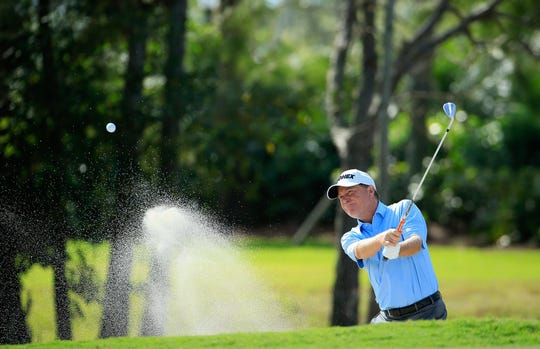Greece native Jeff Sluman, who is playing in the Senior PGA at Oak Hill, hitting a shot from a bunker during the Chubb Classic in February in Naples, Florida.