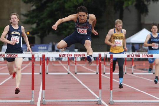 Kennedy's Carlos Saravia competes in the 2A boys 300-meter hurdles during the OSAA 1A/2A State Track and Field Meet at Western Oregon University on Saturday, May 18.
