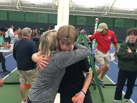 Sprague junior Judson Blair hugs his mother, Rhonda, after falling Saturday in the OSAA Class 6A singles state championship match.