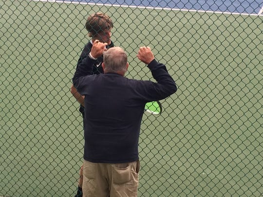Sprague junior Judson Blair talks strategy with coach Gary Wheeler on Saturday during the OSAA Class 6A singles state championship match.