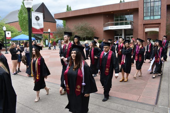 Students process to the quad for the Willamette University College of Liberal Arts Commencement ceremony on Sunday, May 19, 2019.