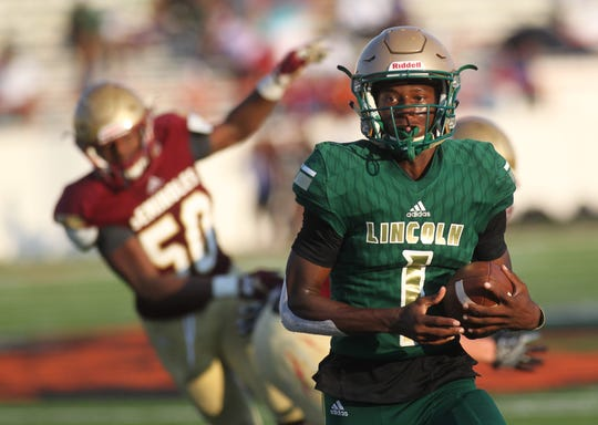 Lincoln quarterback Chris Beard takes off on a big run as the Trojans beat Florida High 28-0 during the Big Bend Spring Football Classic jamboree at Florida A&M's Bragg Memorial Stadium on May 18, 2019.