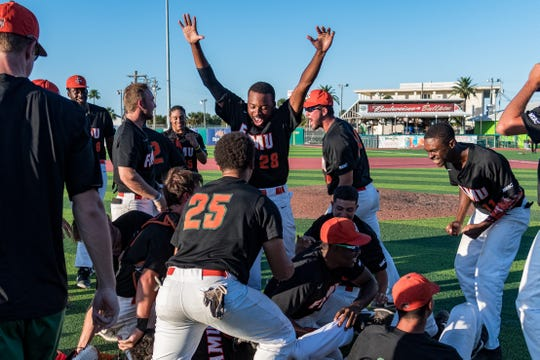 The mob scene on the diamond for FAMU after clinching the MEAC baseball championship at Jackie Robinson Ballpark in Daytona Beach.