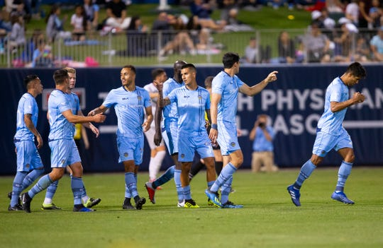 El Paso Locomotive players celebrate their second goal in a match against Sacramento.