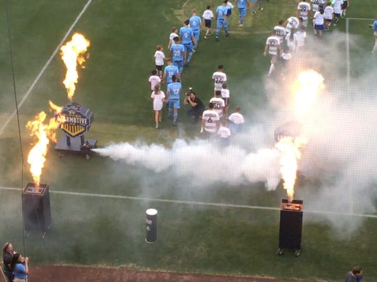 The El Paso Locomotive (left) and Sacramento Republic take the field prior to their USL Championship game with Saturday night at Southwest University Park