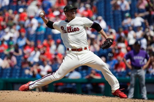 Phillies starting pitcher Jerad Eickhoff throws a pitch during a baseball game against the Colorado Rockies, Sunday.