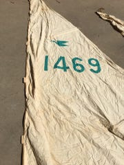 "Original sails of ""Play Baby"" snipe sailboat found in downtown Wichita Falls attic."