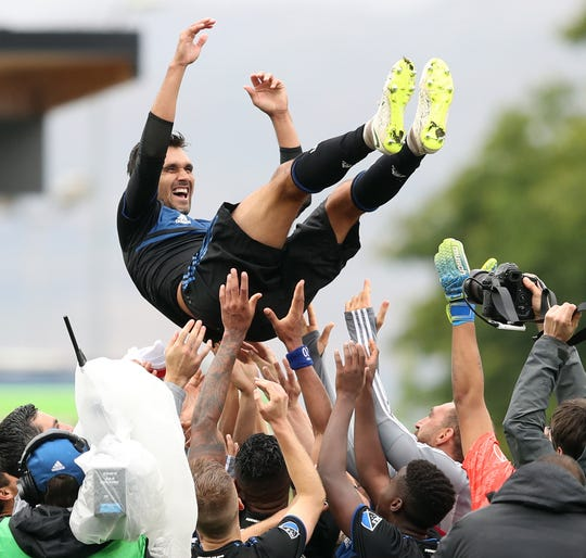 San Jose Earthquakes players throw  Chris Wondolowski into the air after the game against the Chicago Fire.