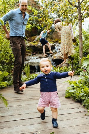 Prince Louis, who turned 1 a few weeks ago, takes off down the bridge as dad Prince William keeps an eye on his progress.