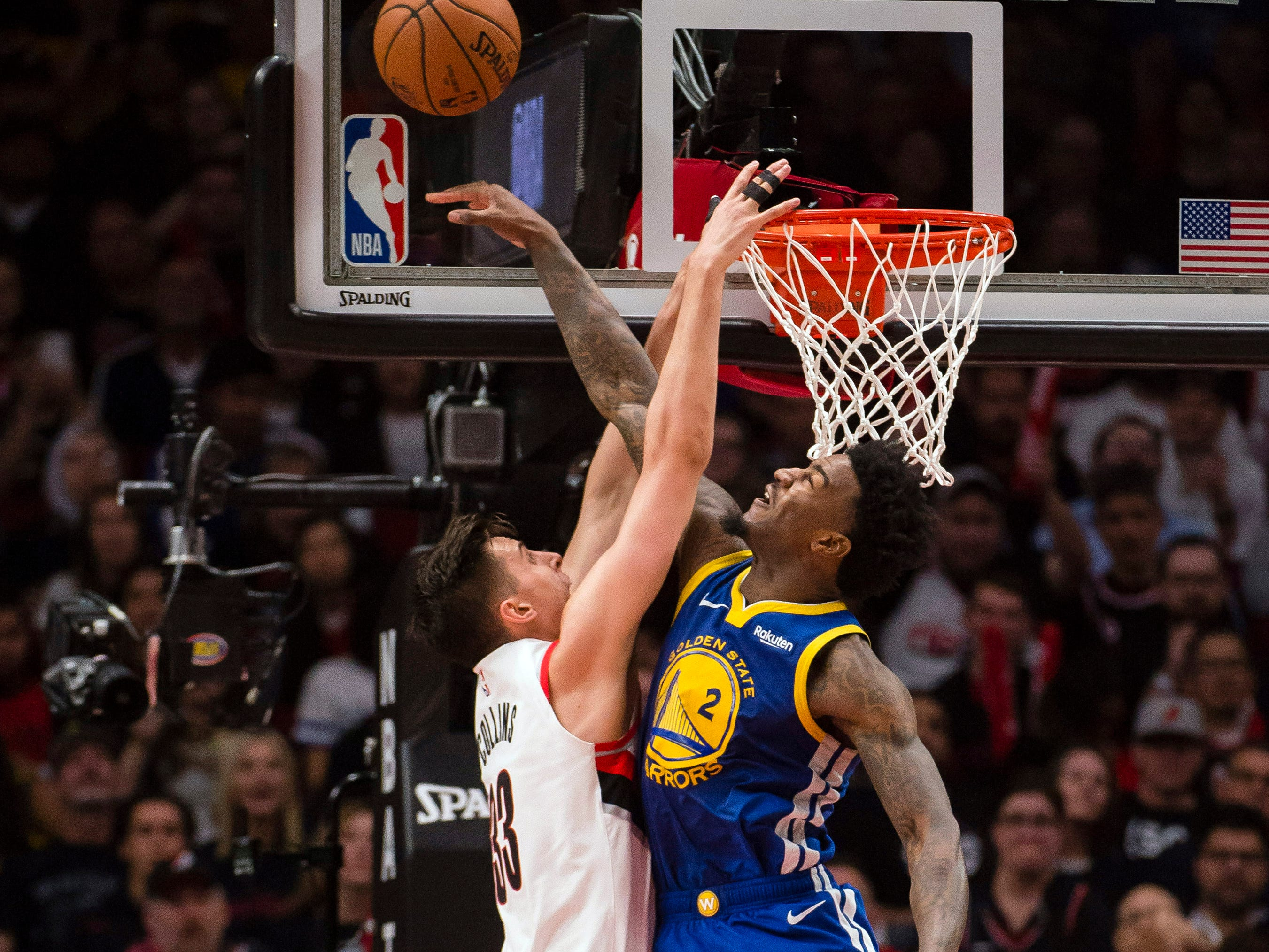 May 1: Warriors defender Jordan Bell (2) blocks a shot attempt by Blazers forward Zach Collins (33) during Game 3.