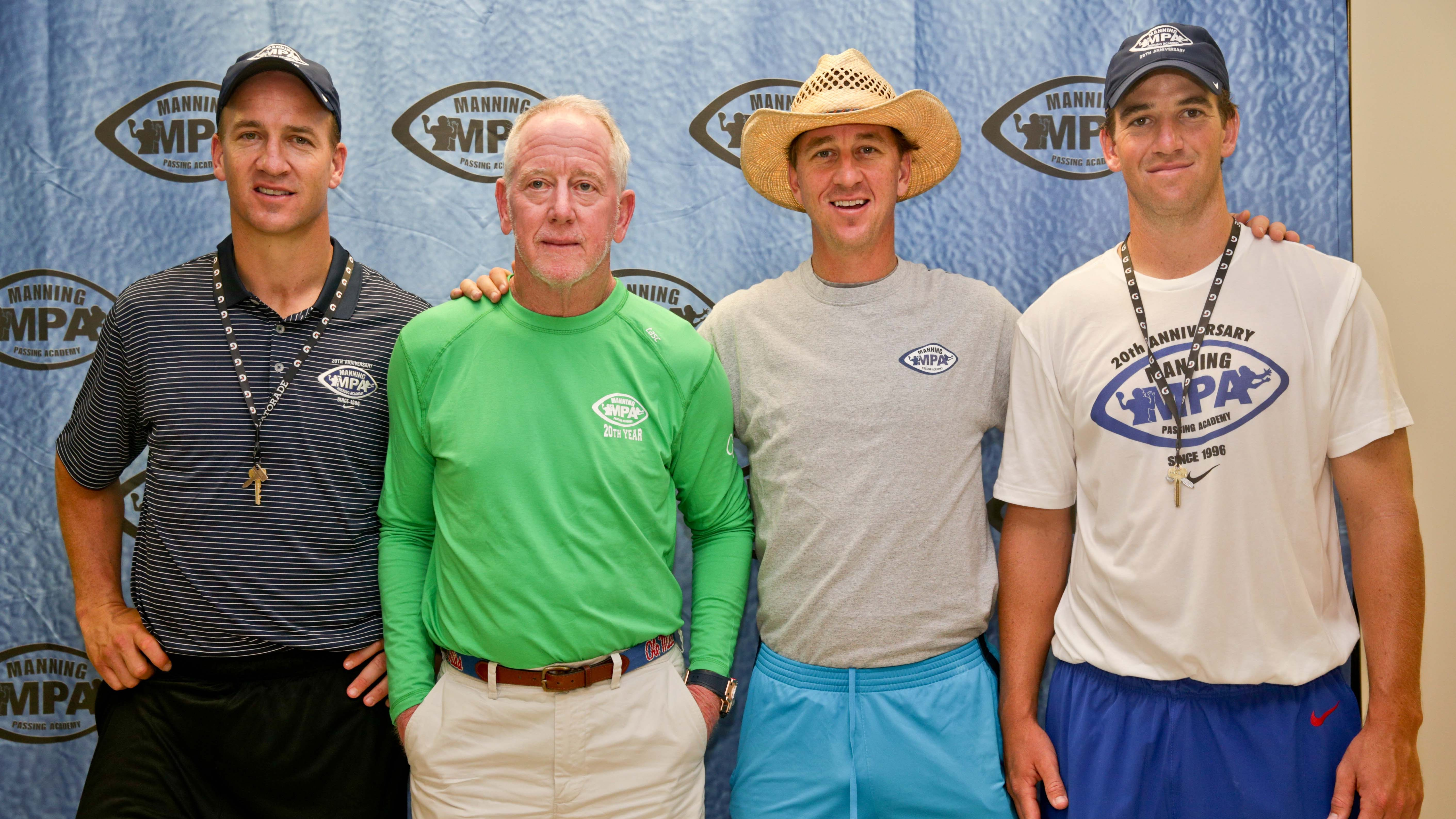 Peyton Manning, Archie Manning, Cooper Manning and Eli Manning pose for a group photo at a press conference at the Manning Passing Academy.