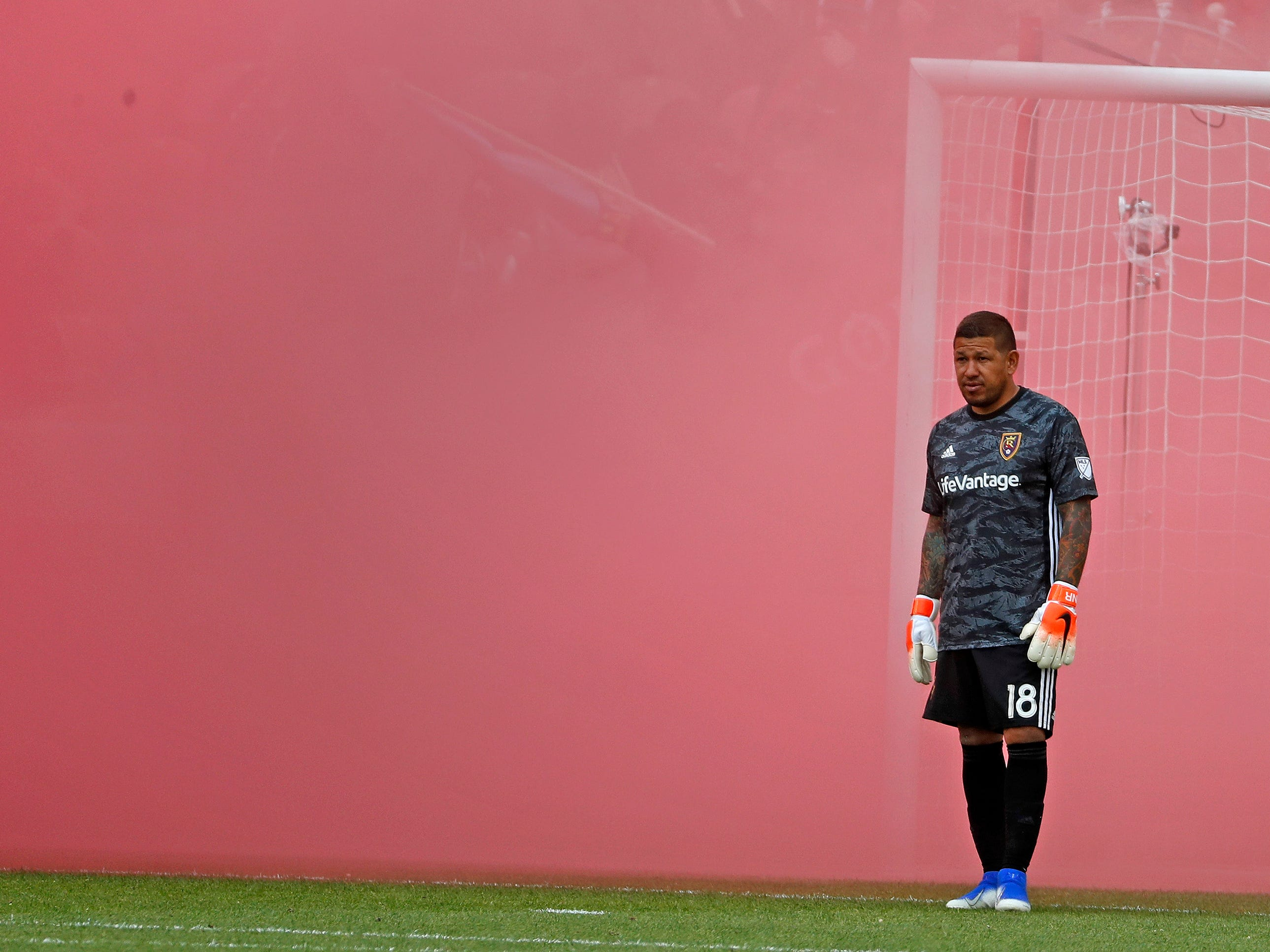 May 18: Real Salt Lake goalkeeper Nick Rimando stands in a cloud of smoke after his teammate forward Jefferson Savarino scored in the second half against the Toronto FC at Rio Tinto Stadium. Real Salt Lake won the game, 3-0.