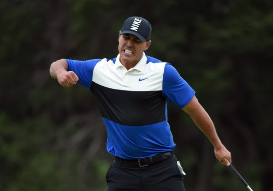Brooks Koepka celebrates after winning the PGA Championship golf tournament at Bethpage State Park - Black Course in Bethpage, N.Y.