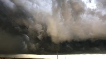 A video taken around sunset shows a massive dark cloud looming over a small town in Oklahoma.