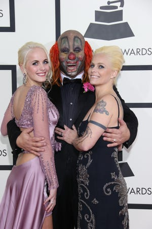 "Gabrielle Crahan, left, at the Grammy Awards in 2014 with her dad, Slipknot's Shawn ""Clown"" Crahan, center, and mom Chantel."