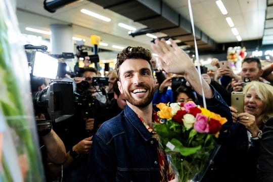 Dutch singer Duncan Laurence is welcomed by fans at Schiphol airport in the Netherlands after winning the 64th annual Eurovision Song Contest with the song 'Arcade.'