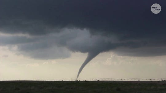A frame grab from a video shows a twister ripping across fields near Forgan, Oklahoma.
