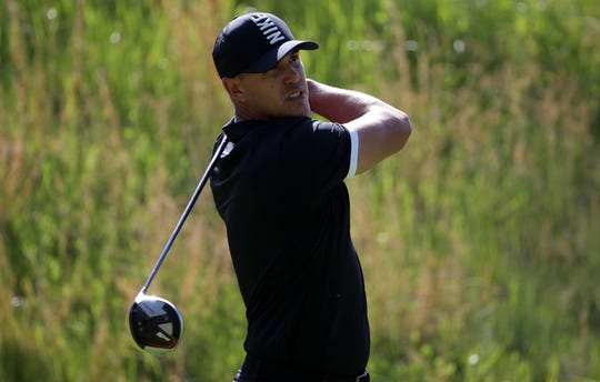 Brooks Koepka plays his shot from the fourth tee during the third round of the PGA Championship.