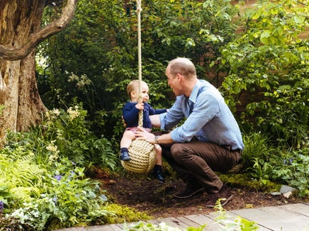 Prince Louis, who just turned 1 in April, gets a push from his dad, Prince William.