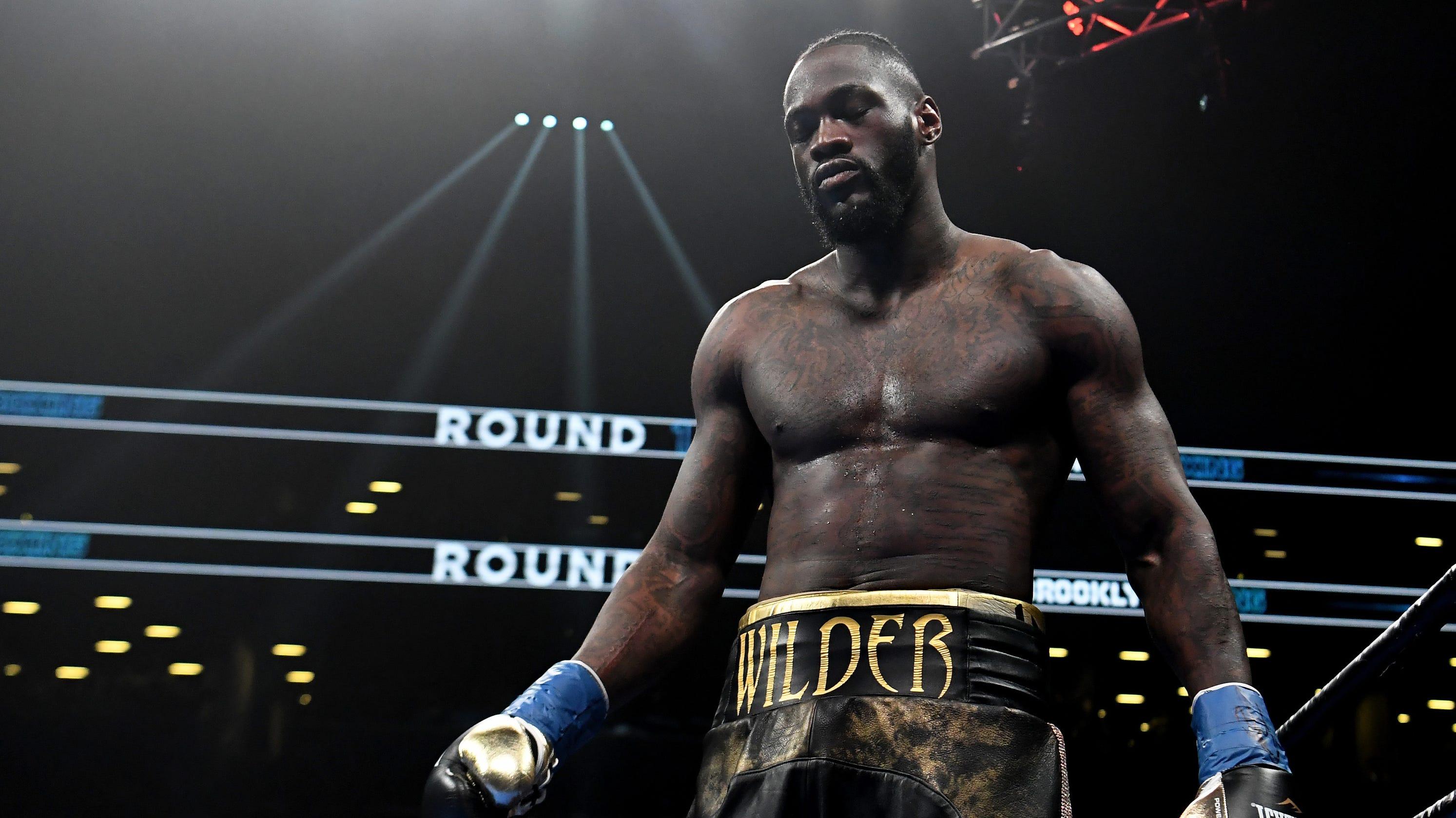 Deontay Wilder KOs Dominic Breazeale in first round to defend heavyweight belt