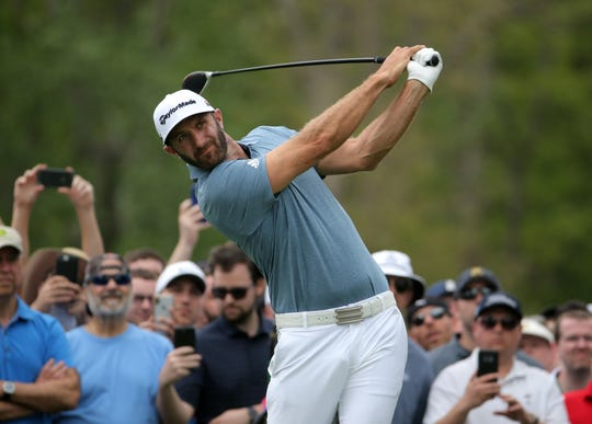 Final round: Dustin Johnson tees off on the sixth hole.