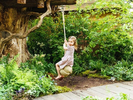 Princess Charlotte swings into the fun at a tree house in the garden Duchess Kate of Cambridge created with the Royal Horticultural Society.