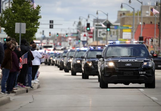 The funeral procession for Appleton firefighter Mitch Lundgaard makes its way down West Wisconsin Avenue.