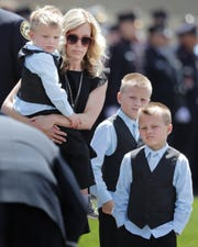 The family of Appleton firefighter Mitchell F. Lundgaard, as the funeral procession stops in front of the Appleton Alliance Church on Monday, May 20, 2019, in Grand Chute, Wis.The 14-year veteran of the Appleton Fire Department was fatally shot while responding to a medical emergency at the downtown Valley Transit Center on Wednesday, May 15, 2019 in Appleton, Wis. 