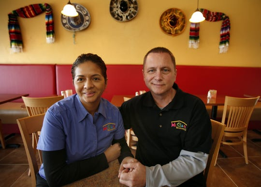 In this photo from 2012, Mi Casa owners Michael Whiting and Maria Hernandez Rodriguez, husband and wife, sit in the dining room of their restaurant in Appleton.