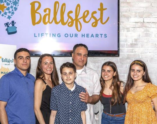 Augustus Maggio (center, front) with family members (left to right): Brother Pasquale Maggio, mom Natalie Maggio, dad Anthony Maggio, and sisters Adria Maggio and Serena Maggio.