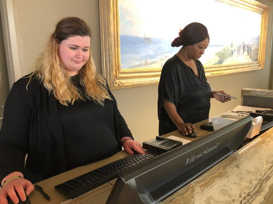 Emily Smith, left, and Chandra Daniels work at the front desk at Ocean Place Resort & Spa in Long Branch.