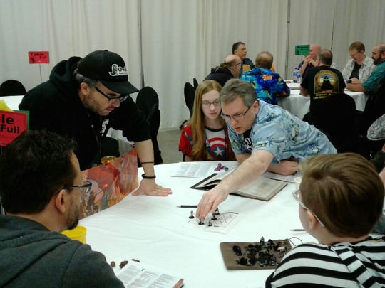 "Brian Stillman, standing left, leads a ""Dungeons & Dragons"" game. Stillman is the co-director of the new documentary ""Eye of the Beholder: The Art of Dungeons & Dragons."""