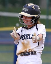 Howell's Alexis Post gives thumbs up after hitting a 3-run double against Freehold Township at home Monday, May 20, 2019.