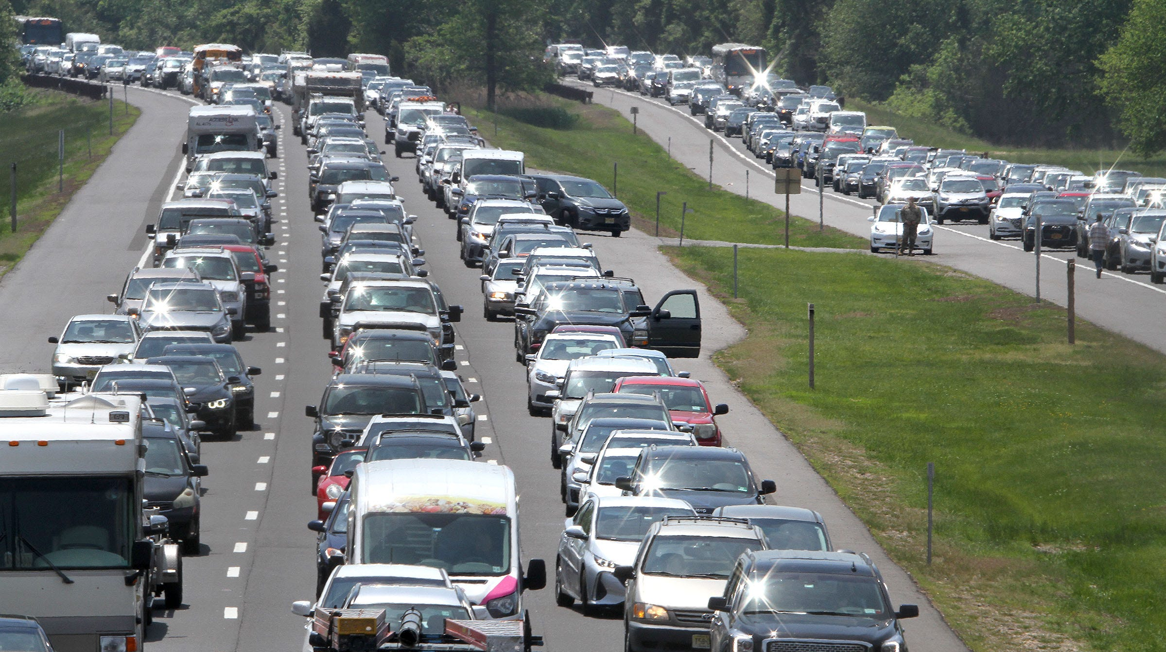 Traffic is stopped on the Garden State Parkway northbound about 2 miles south of Exit 109 where power lines had fallen across the roadway closing all north and southbound lanes in Middletown Monday, May 20, 2019.