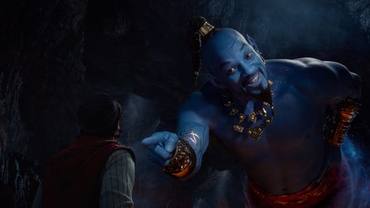 "Aladdin (Mena Massoud) meets the larger-than-life blue Genie (Will Smith) in Disney's live-action adaptation ""Aladdin,"" directed by Guy Ritchie."
