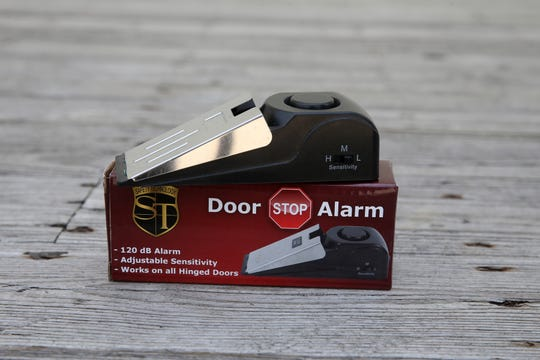 Cindy Brennan of Ocean Gate, owner of Momma Bear's Defense, a business that sells personal alarms, cameras, pepper spray and other self-defense items, talks about her business and displays a door stop alarm on the boardwalk in Asbury Park, NJ Monday May 20, 2019.