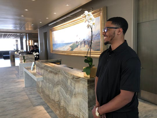 Ajhan Wilson, a bellman at Ocean Place Resort & Spa in Long Branch, on his first day at work.