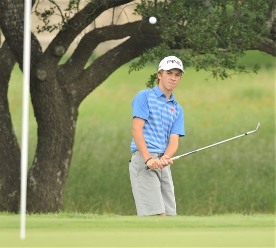 Cooper freshman hits onto the green at 16 during the first day of the Class 5A state golf tournament.