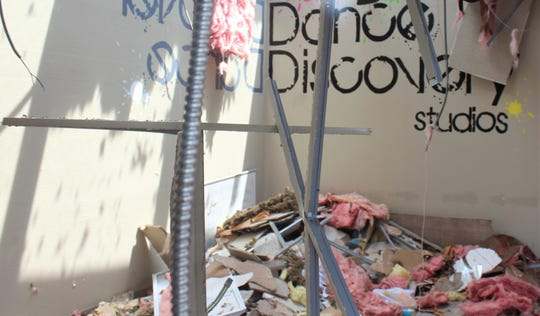 The interior of Dance Discovery Studios is full of debris Monday.