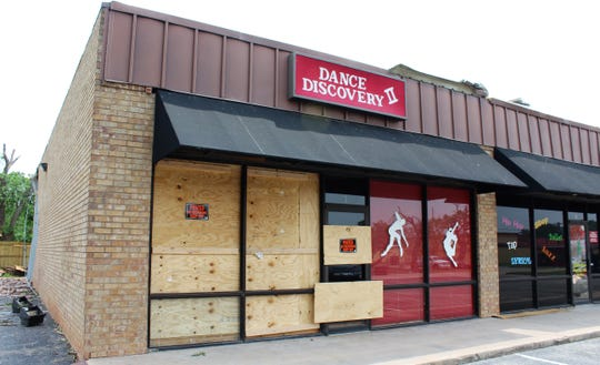 Dance Discovery Studio, boarded up with its roof missing, was closed Monday. May 20 2019