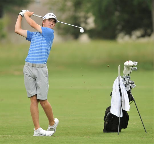 Cooper freshman Karson Grigsby hits from the fairway at 15 during the first day of the Class 5A state golf tournament Monday, May 20, 2019, at White Wing Golf Club in Georgetown. Grigsby shot 7-over-par 79 to go into the final day tied with six others for 37th and 10 shots off the leaders.
