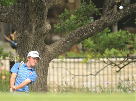 Cooper freshman Karson Grigsby tries to chip onto the green at 15. The shot sailed over the turtleback green and into a similar spot on the other side of the green at the Class 5A state tournament Monday at White Wing Golf Club in Georgetown.
