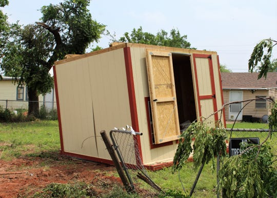 A storage shed behind Dance Discovery Studios in the 3300 block of South Second Street, was blown onto its roof by Saturday's tornado in Abilene.