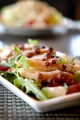 The grilled octopus salad at Cedric's Tavern on the Biltmore Estate is served with charred feta and pickled grapes.