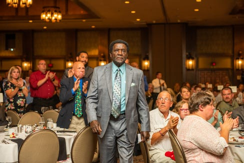 Gene Hammonds, longtime coach at Asheville High, accepts the MOOG/Gene Ochsenreiter Award for Lifetime Achievement on May 19, 2019. The Mountain Amateur Athletic Club's 58th WNC Sports Awards Banquet also honored more than a hundred high school athletes at the Omni Grove Park Inn.
